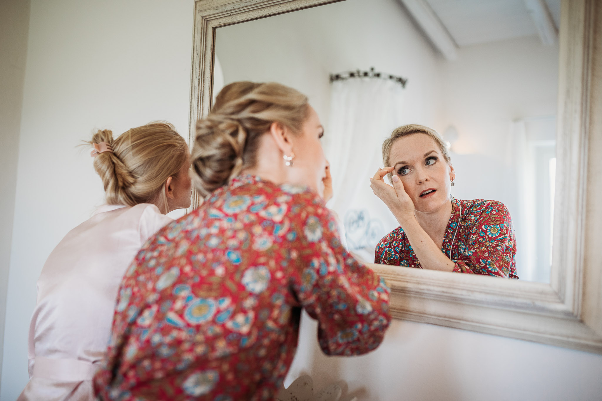 Bride in her dressing gown while getting ready at La Villa Hotel, Mombaruzzo