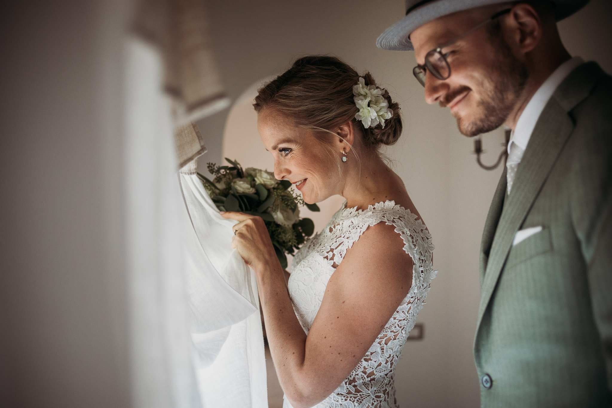 Bride and groom are getting ready for their wedding ceremony at La Villa Hotel, Mombaruzzo