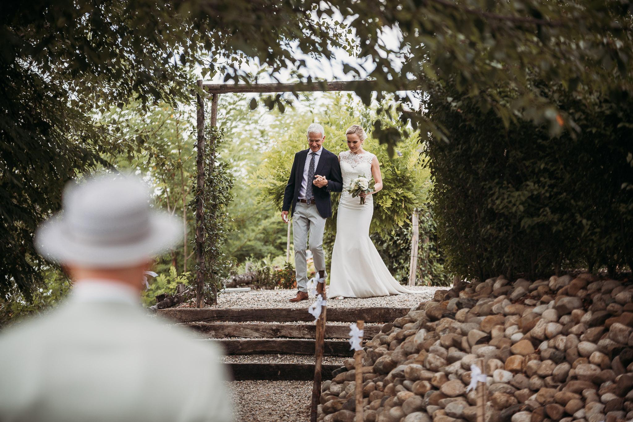 The bride arrives atthe wedding ceremony terrace on the countryside at La Villa Hotel, Mombaruzzo