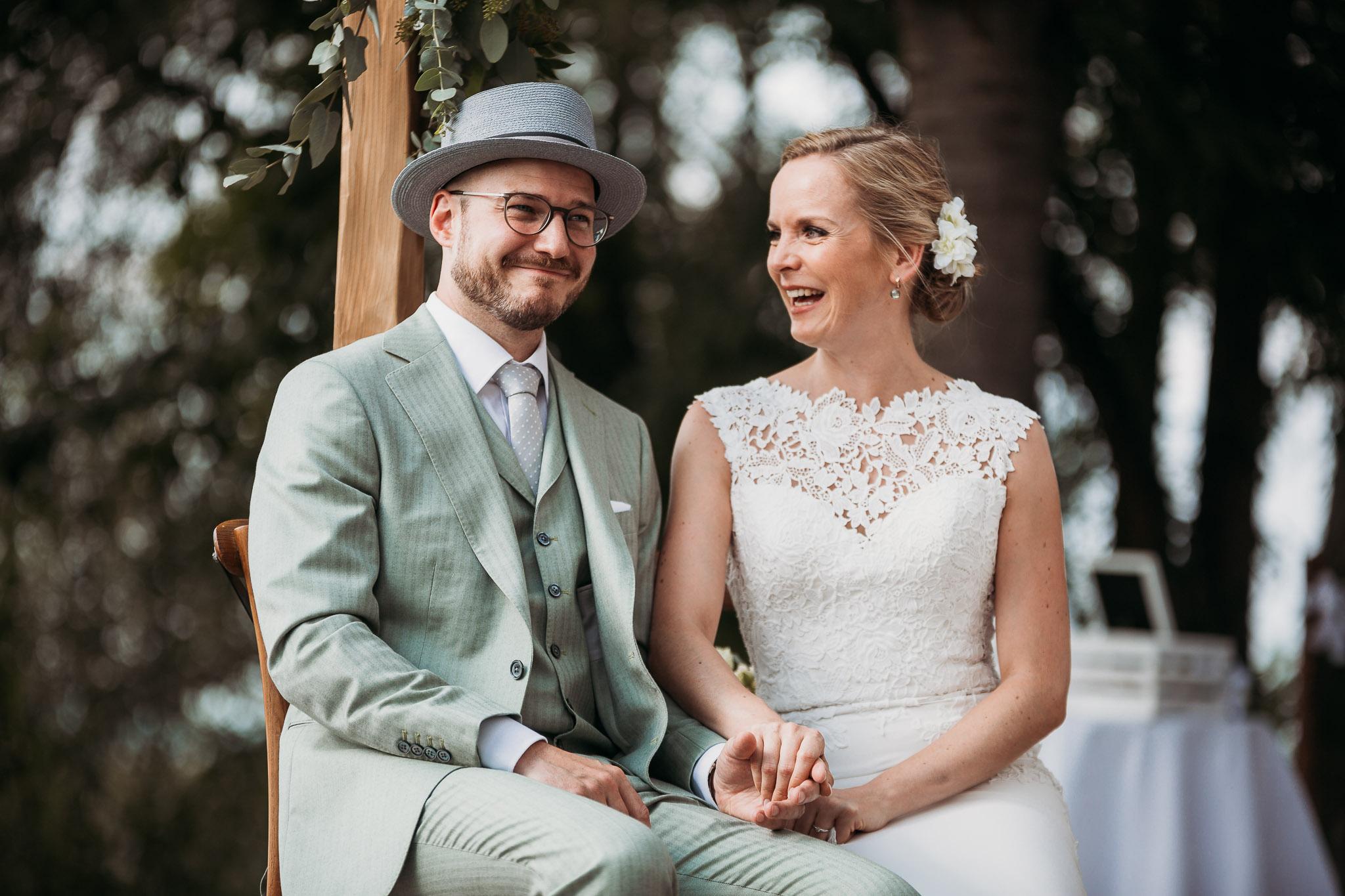 Happy bride and groom at their wedding ceremony at La Villa Hotel, Mombaruzzo