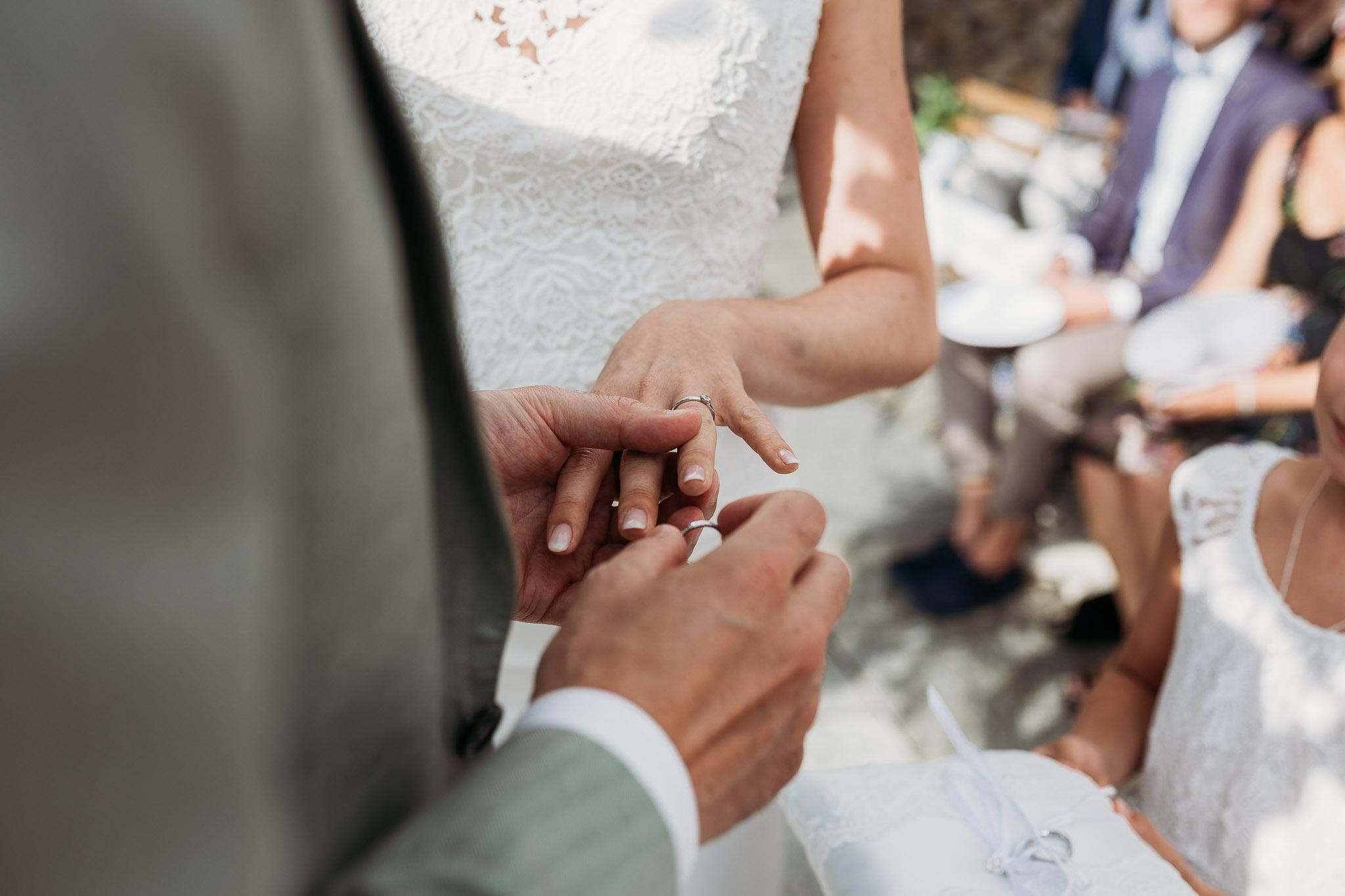 Wedding rings during the ceremony at La Villa Hotel, Mombaruzzo