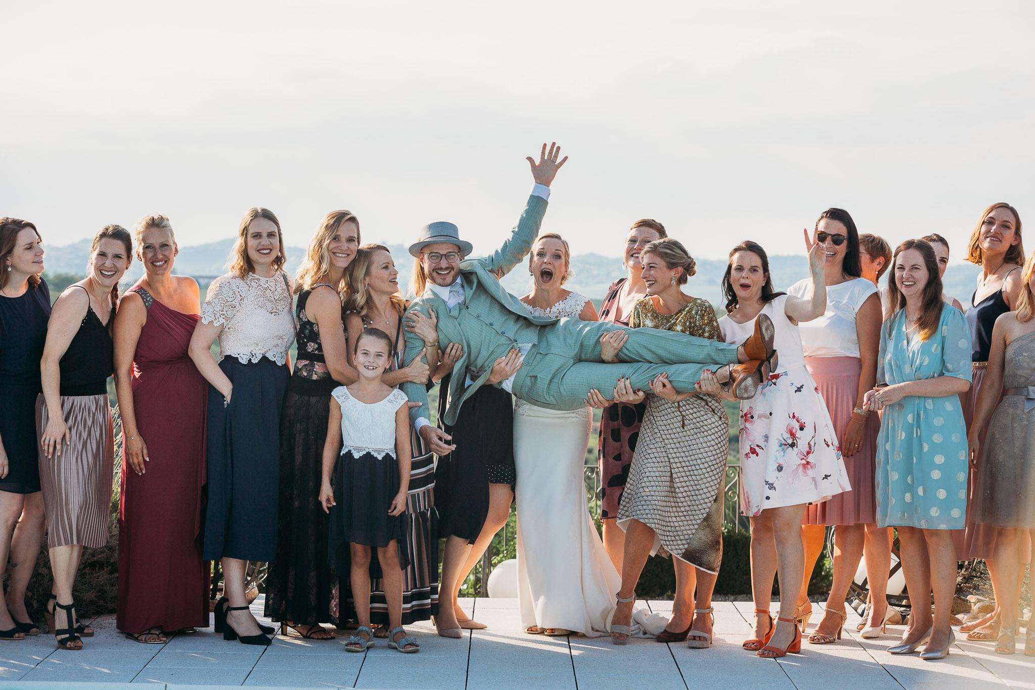 Formal weddign photo of newlyweds and friends at La Villa Hotel, Mombaruzzo