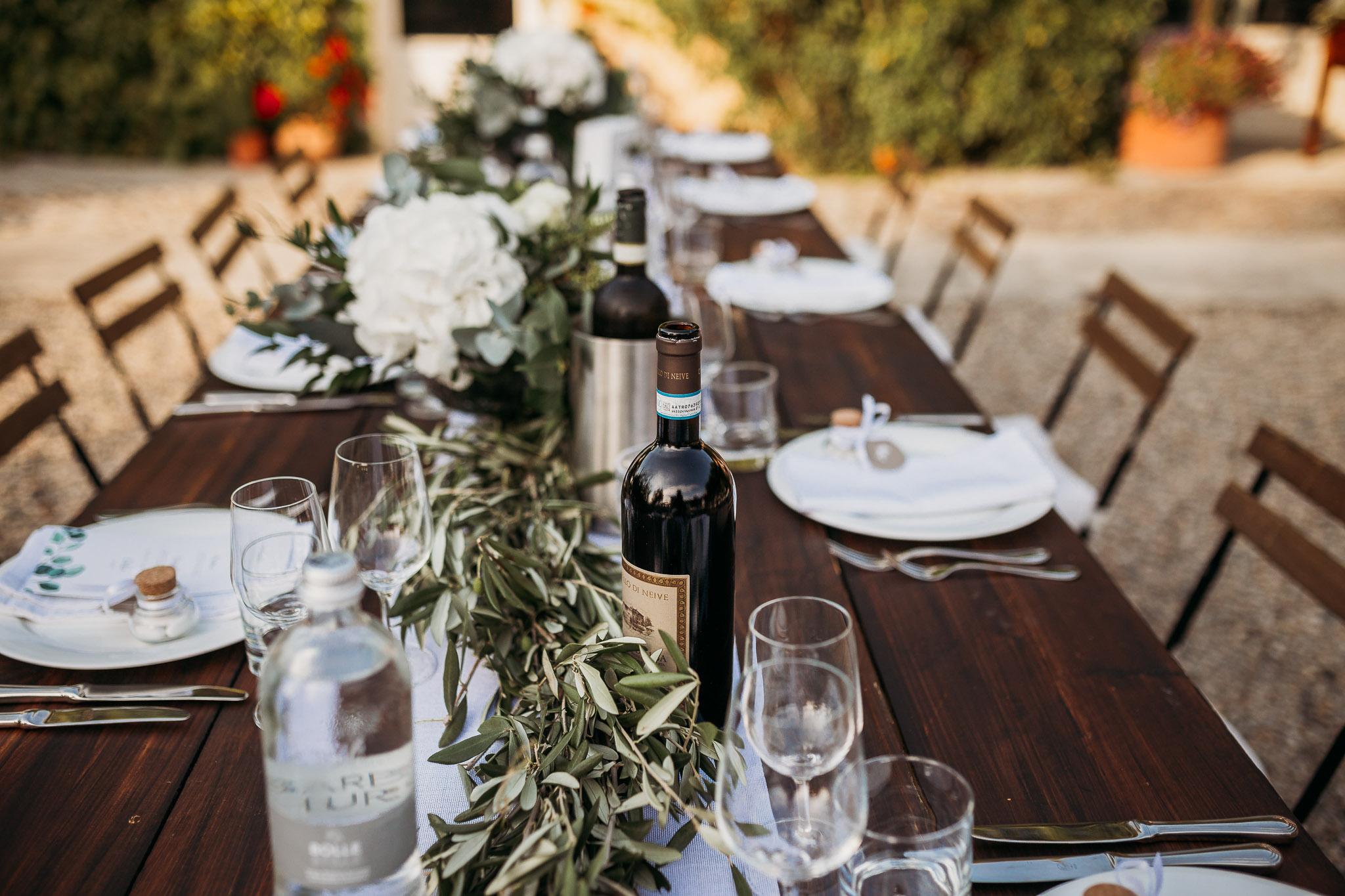 Table ready for wedding reception in the courtyard at La Villa Hotel, Mombaruzzo