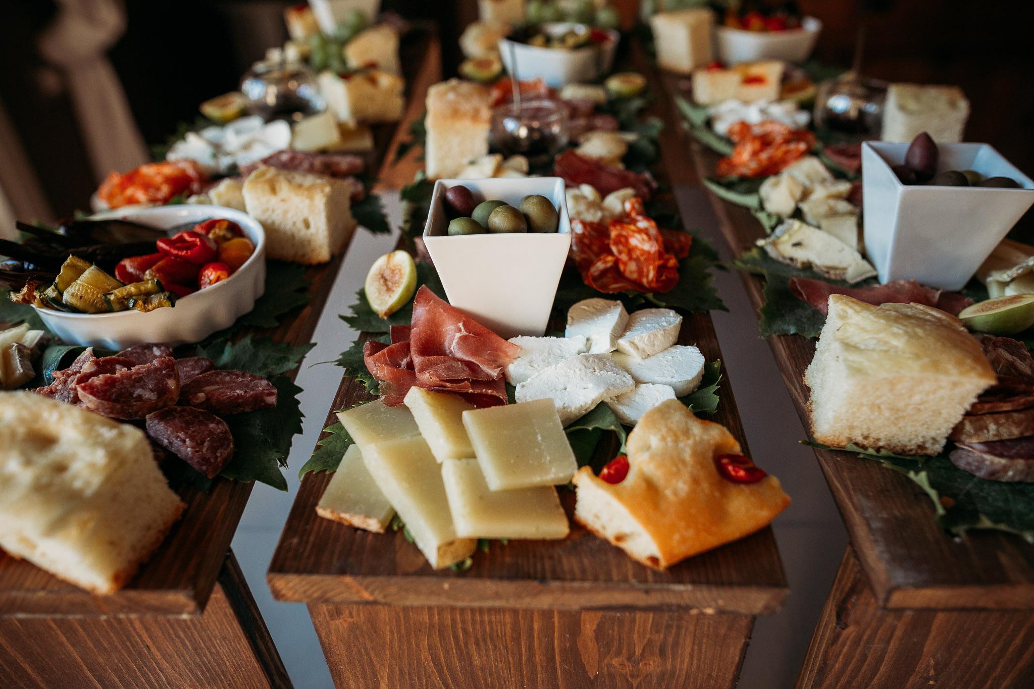 Italian wedding aperitivo with bread, cheese and olives at La Villa Hotel, Mombaruzzo