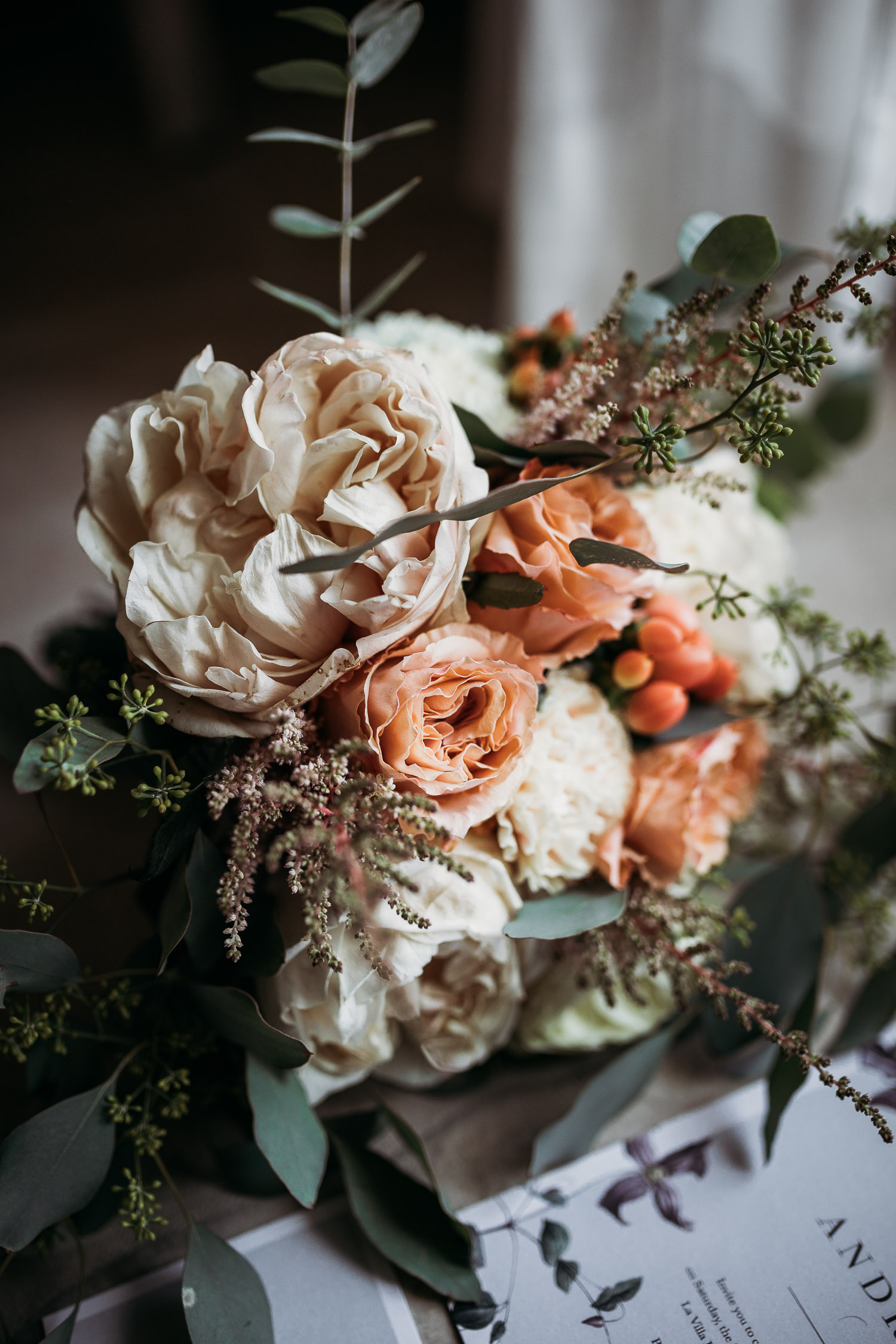 Bride bouquet with avory and peach peonies and berries at La Villa Hotel Mombaruzzo