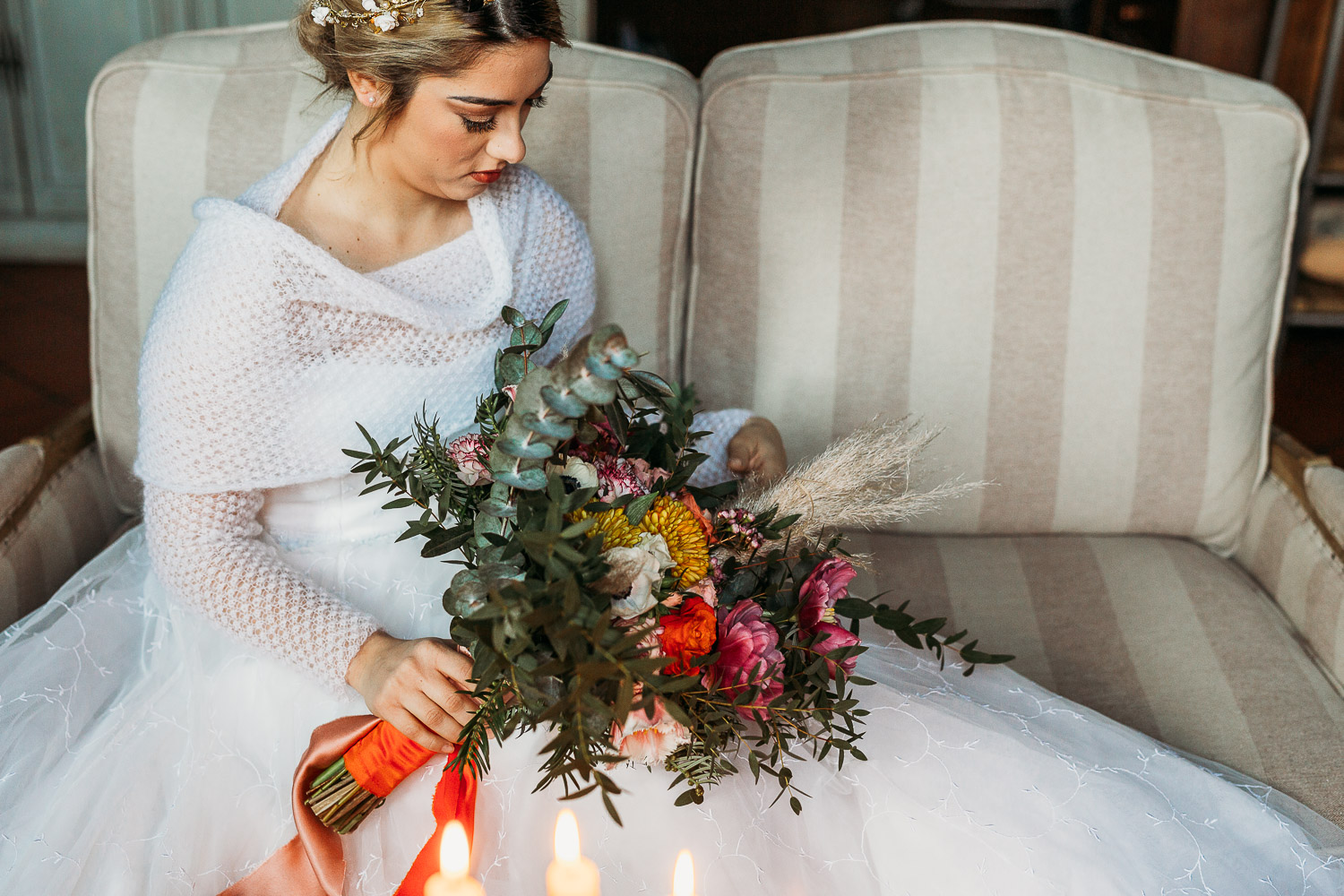 Bride wearing a Marianna Lanzilli tulle dress holding a peach orange pink bouquet at Tenimento al Castello