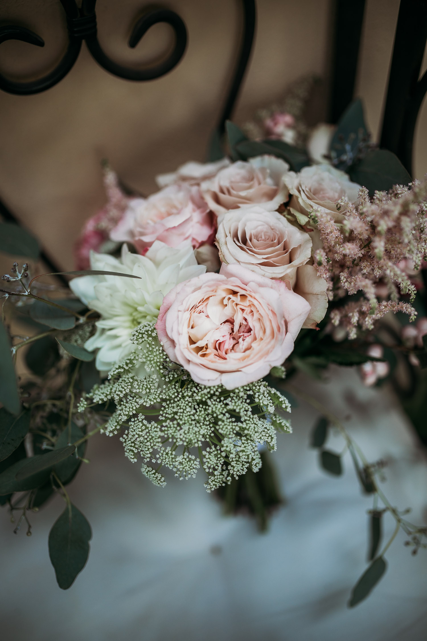 Pale pink peonies and white roses with eucalyptus for a romantica bouquet at La Villa Hotel