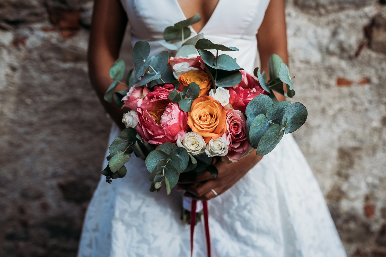 Bride holding a strong color bouquet