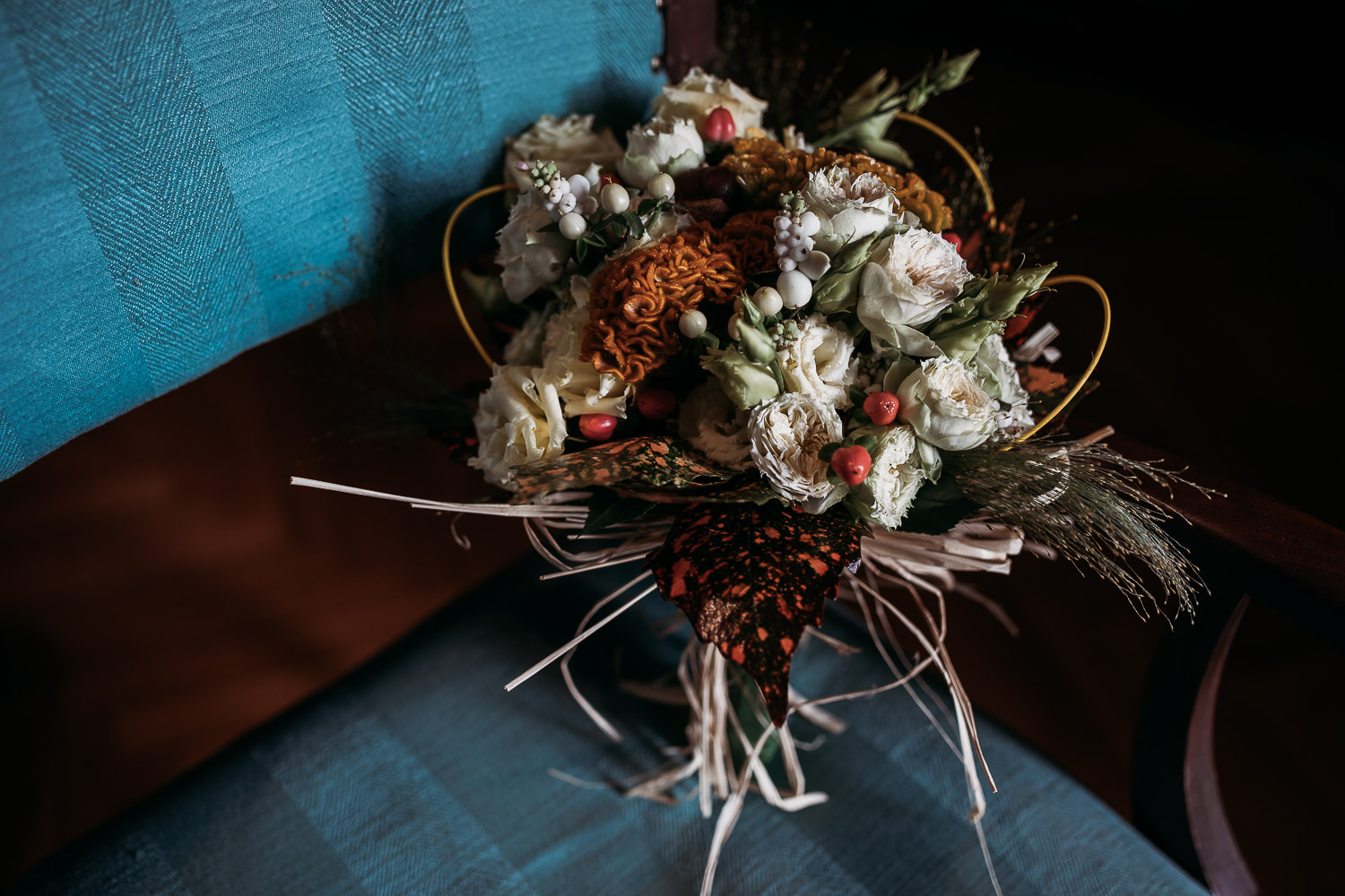 Autumnal bouquet with red berries and orange details