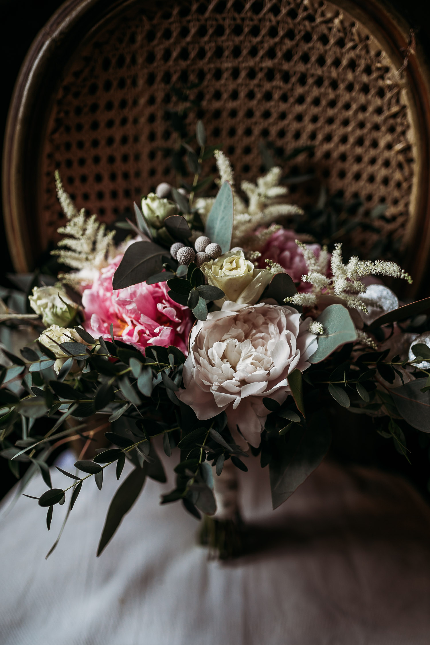 Whimsical bouquet with big pink flowers and astilbe for a wedding at Castello di Collegno