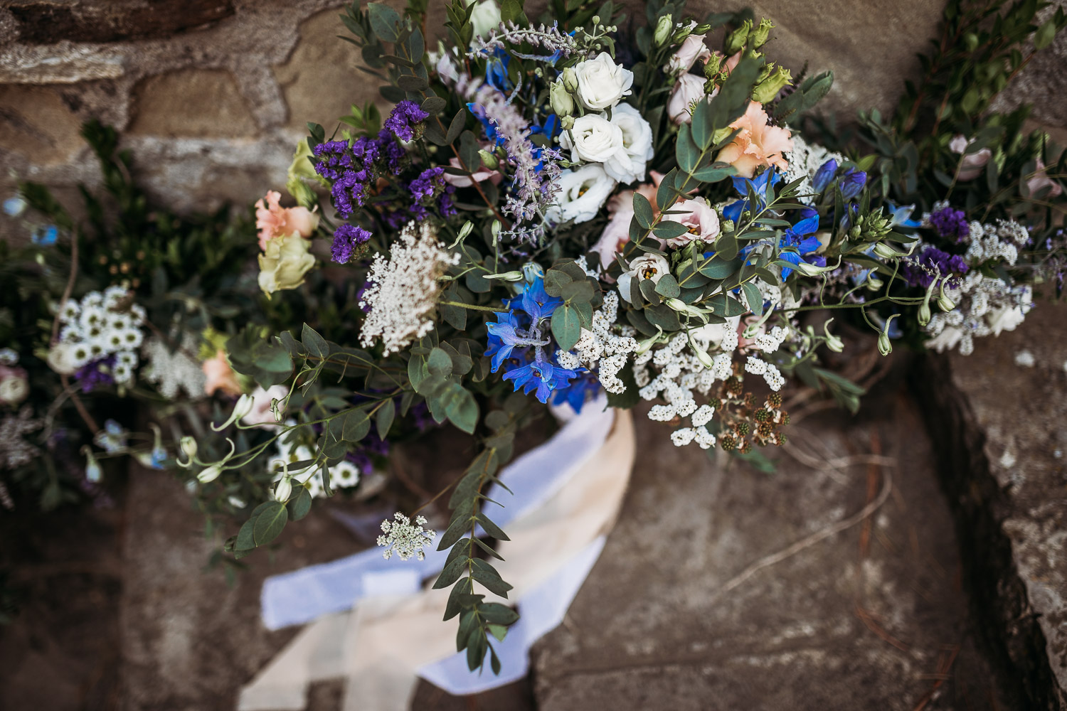 Wedding bouquet with blue and violet wildflowers made by Roberta Turco