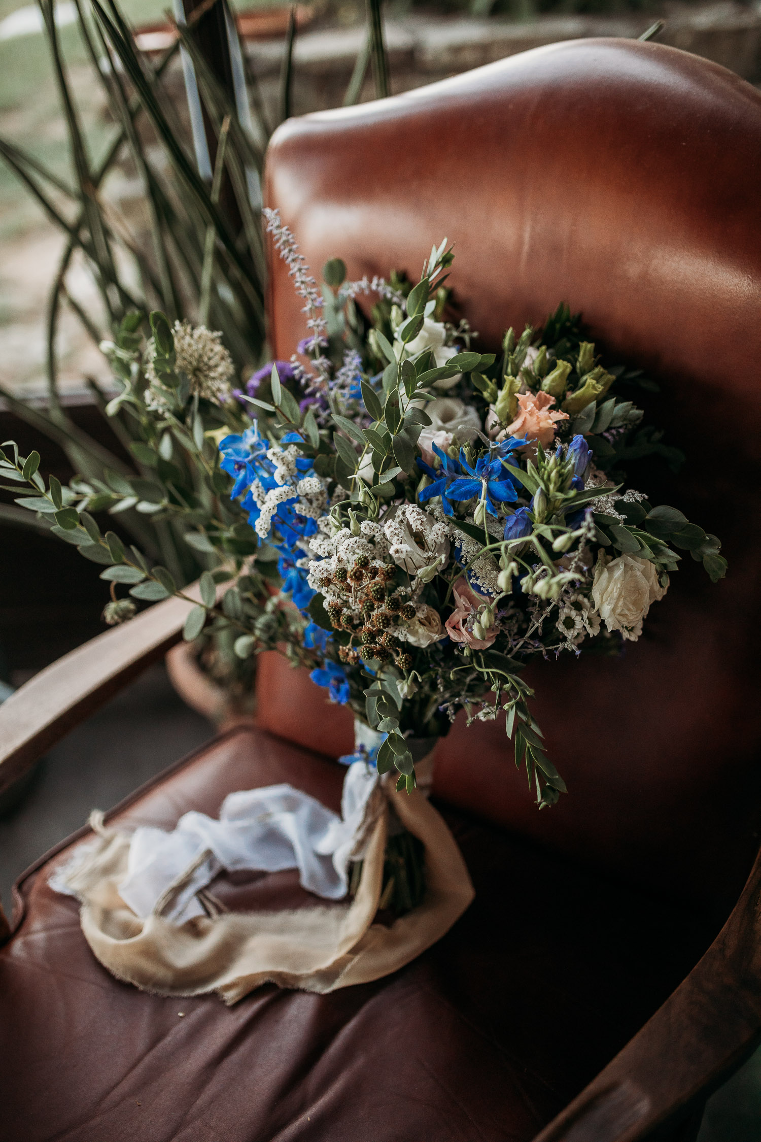 Rustic bouquet with blue wildflowers and cotton ribbons