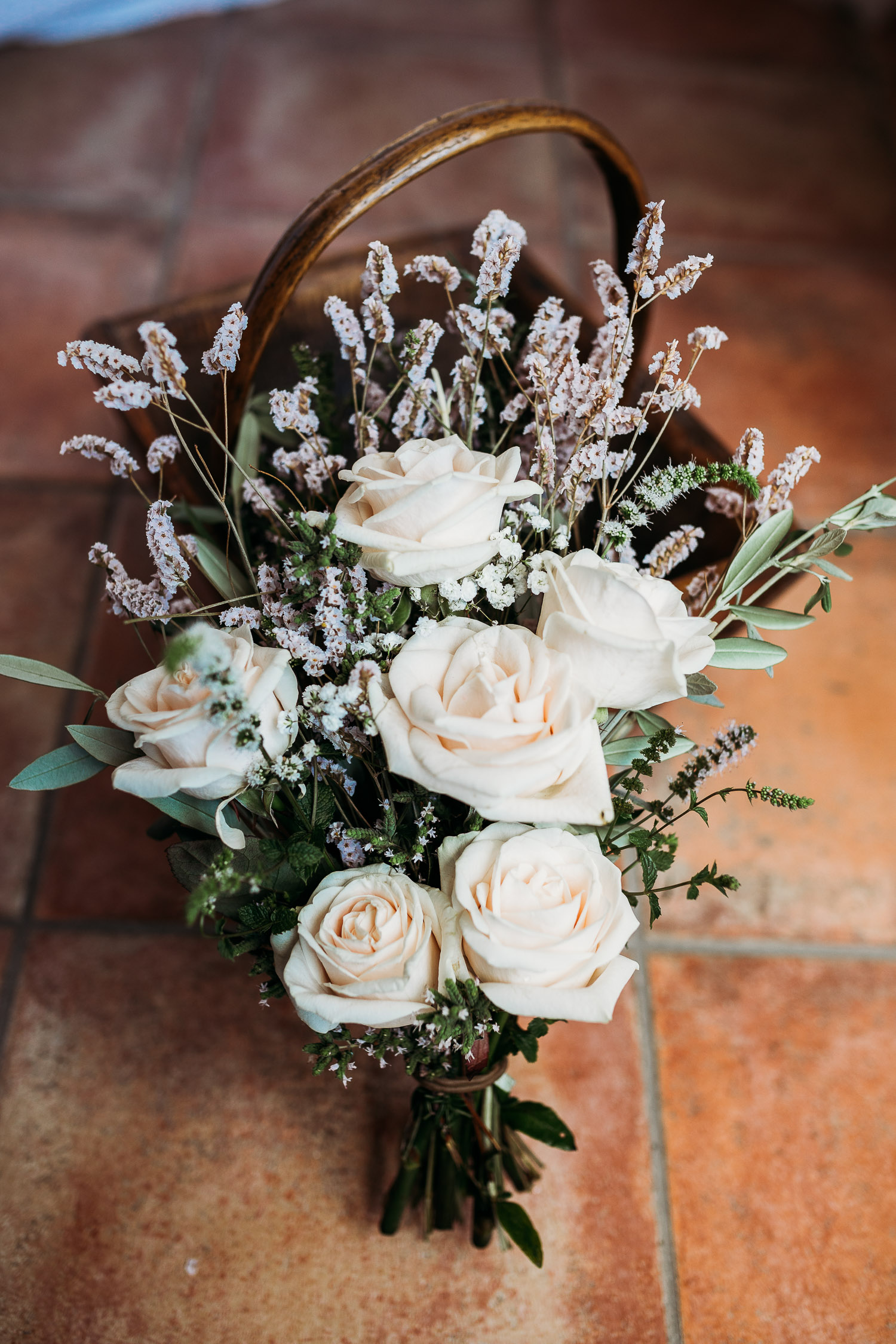 Simple small bouquet with white roses and little flowers