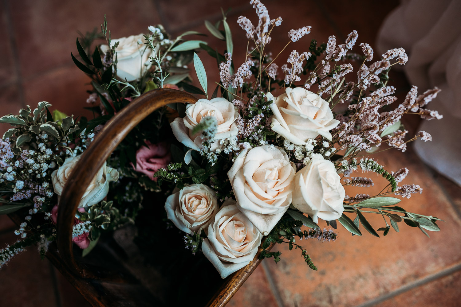 Bridal bouquet with white roses in a basket