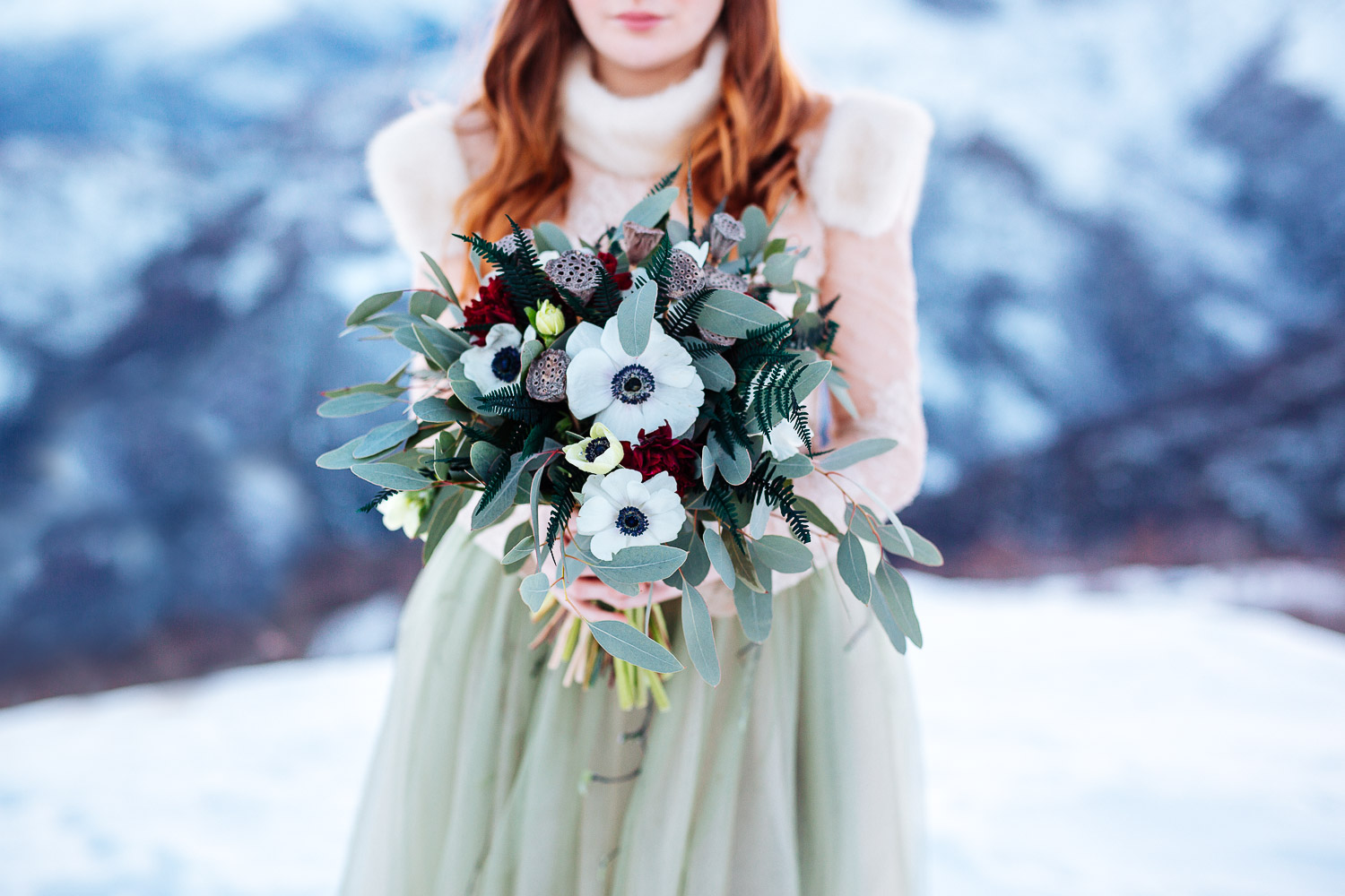 Winter wedding bouquet wih anemone and dark red flowers
