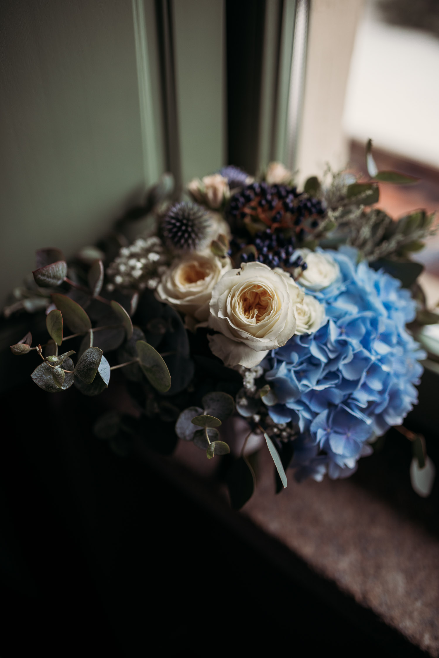 Bridal bouquet with blue hydrangea and light