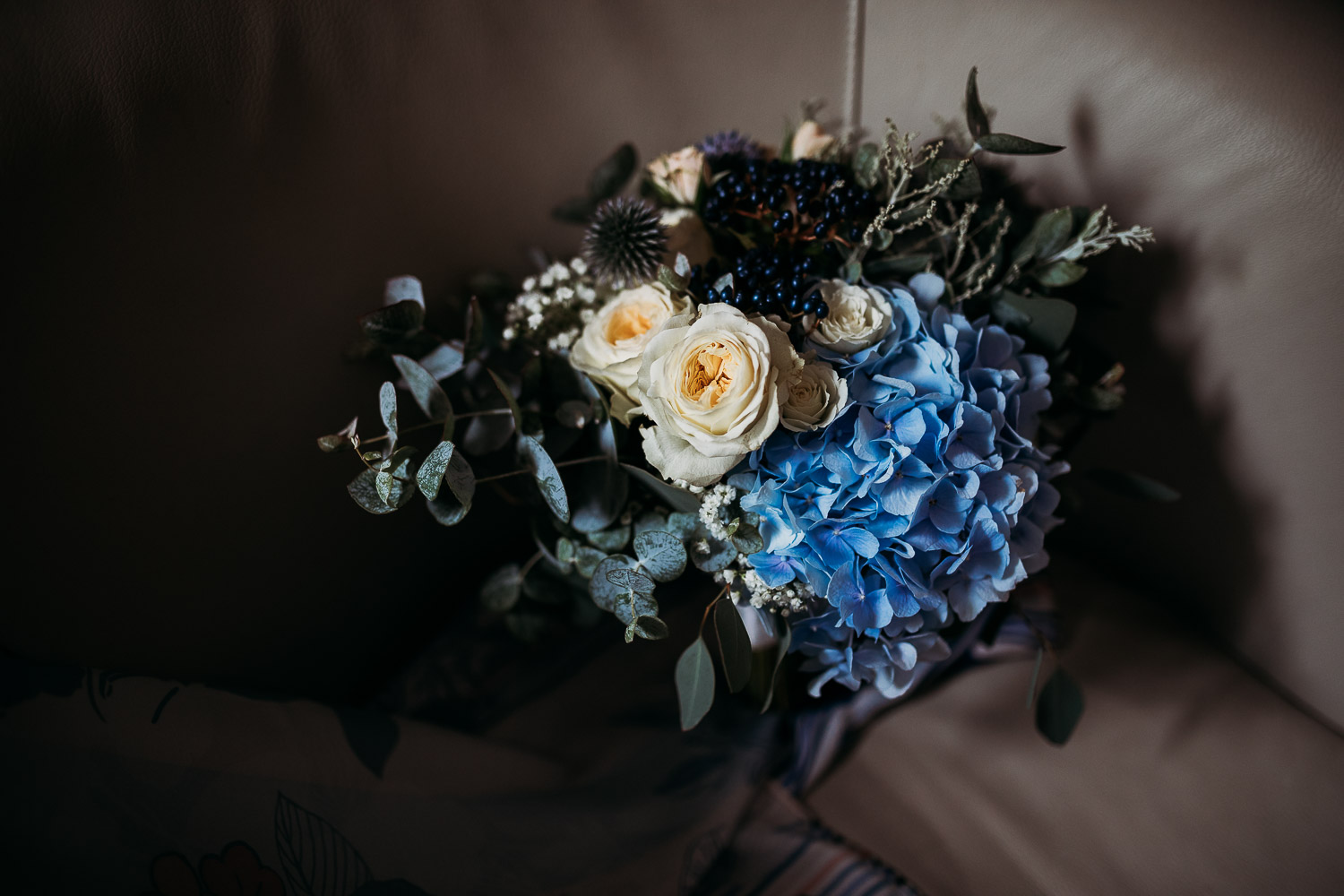 White roses and blue hydrangea for a wedding bouquet