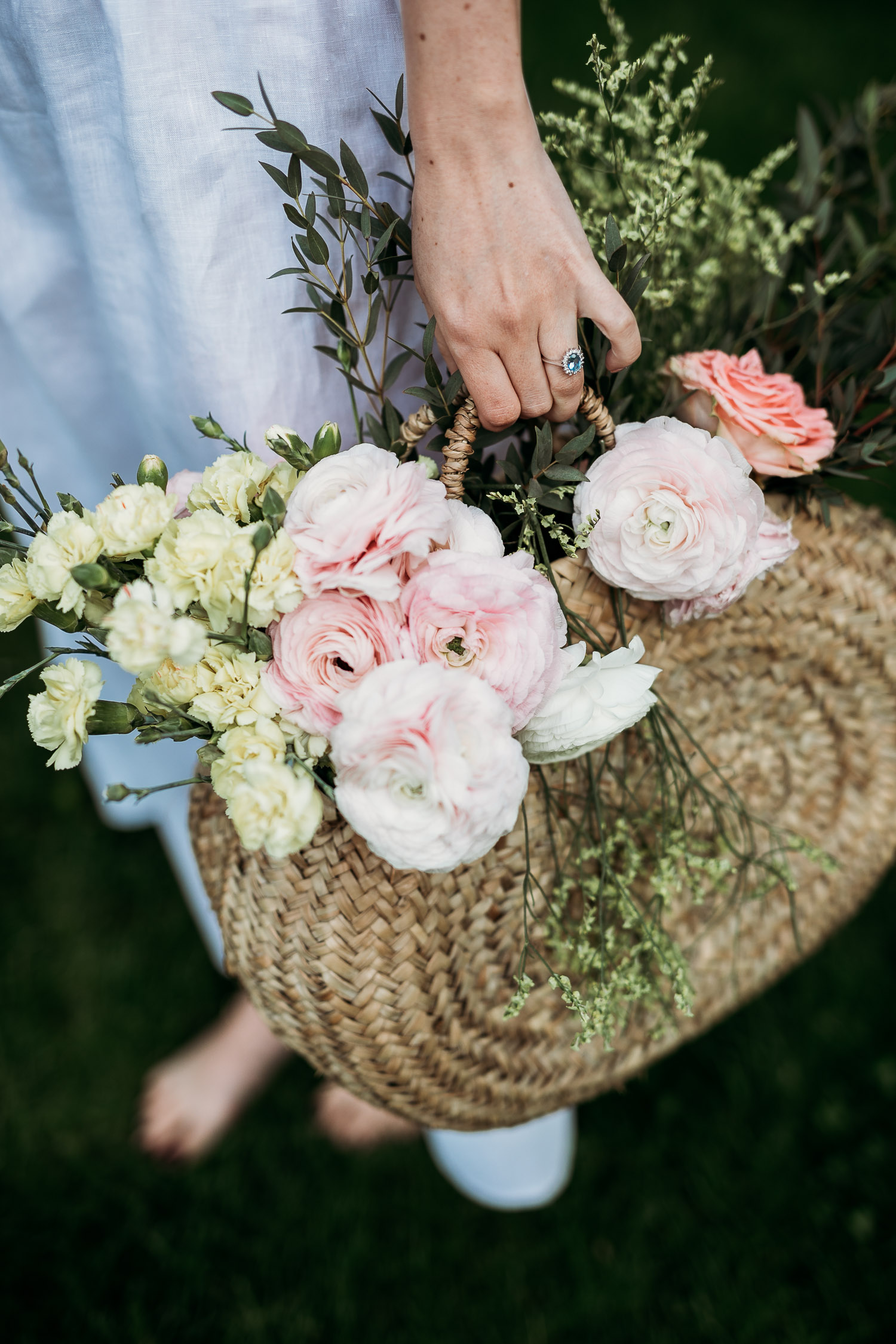 Basket of flowers for a boho barefoot bride