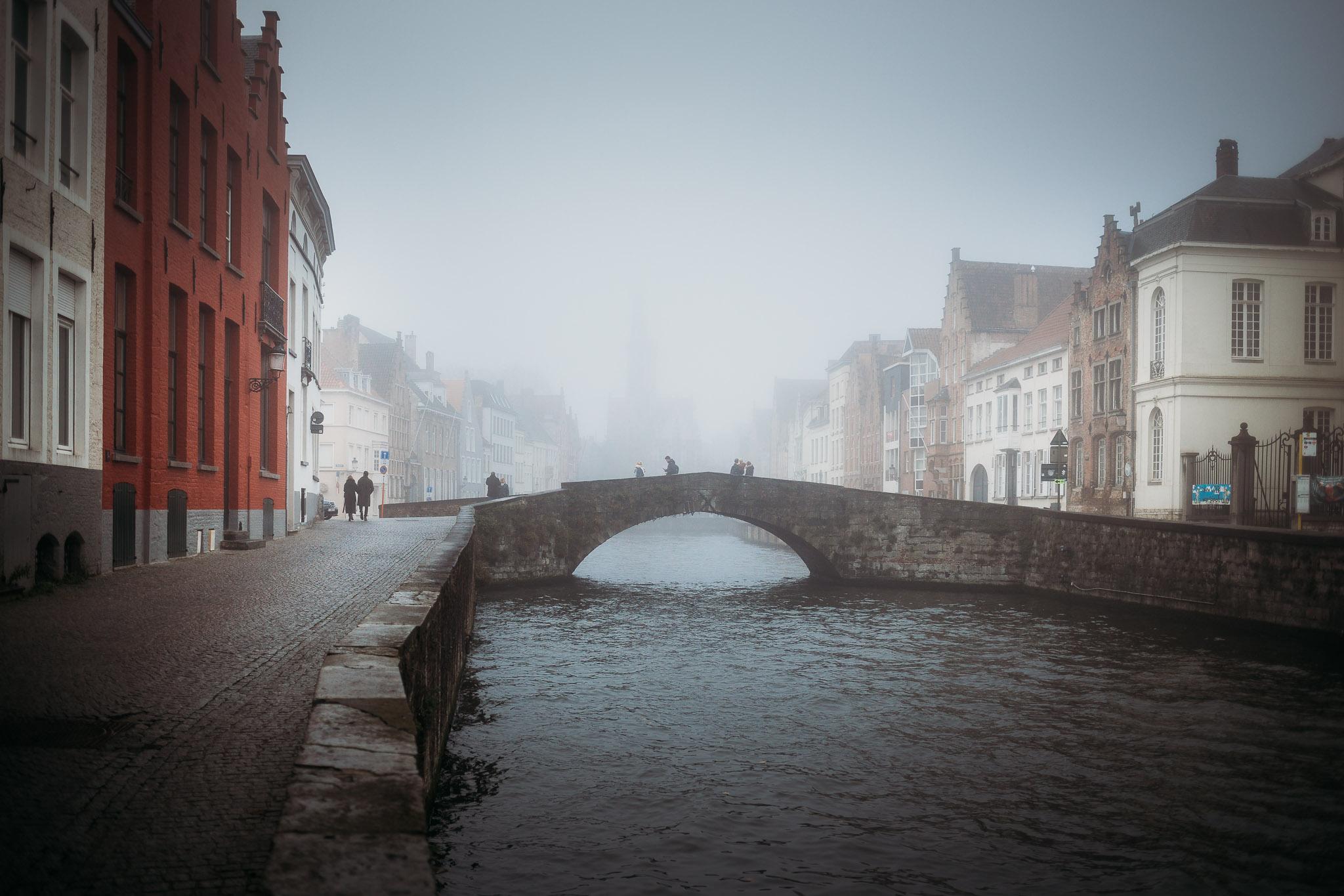 Misty canal in Bruges, Belgium
