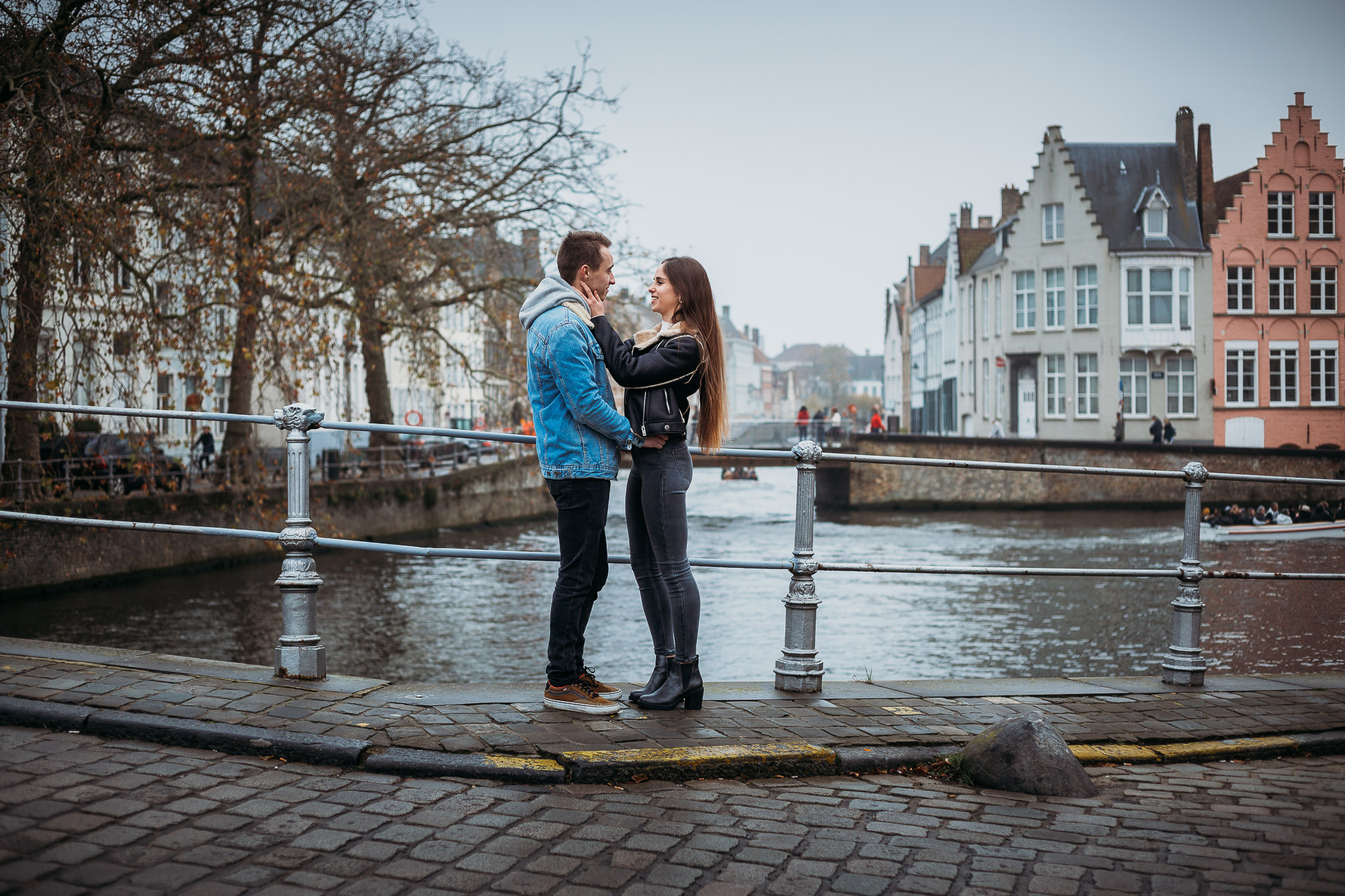 Couple meeting on a bridge in Bruges, Belgium
