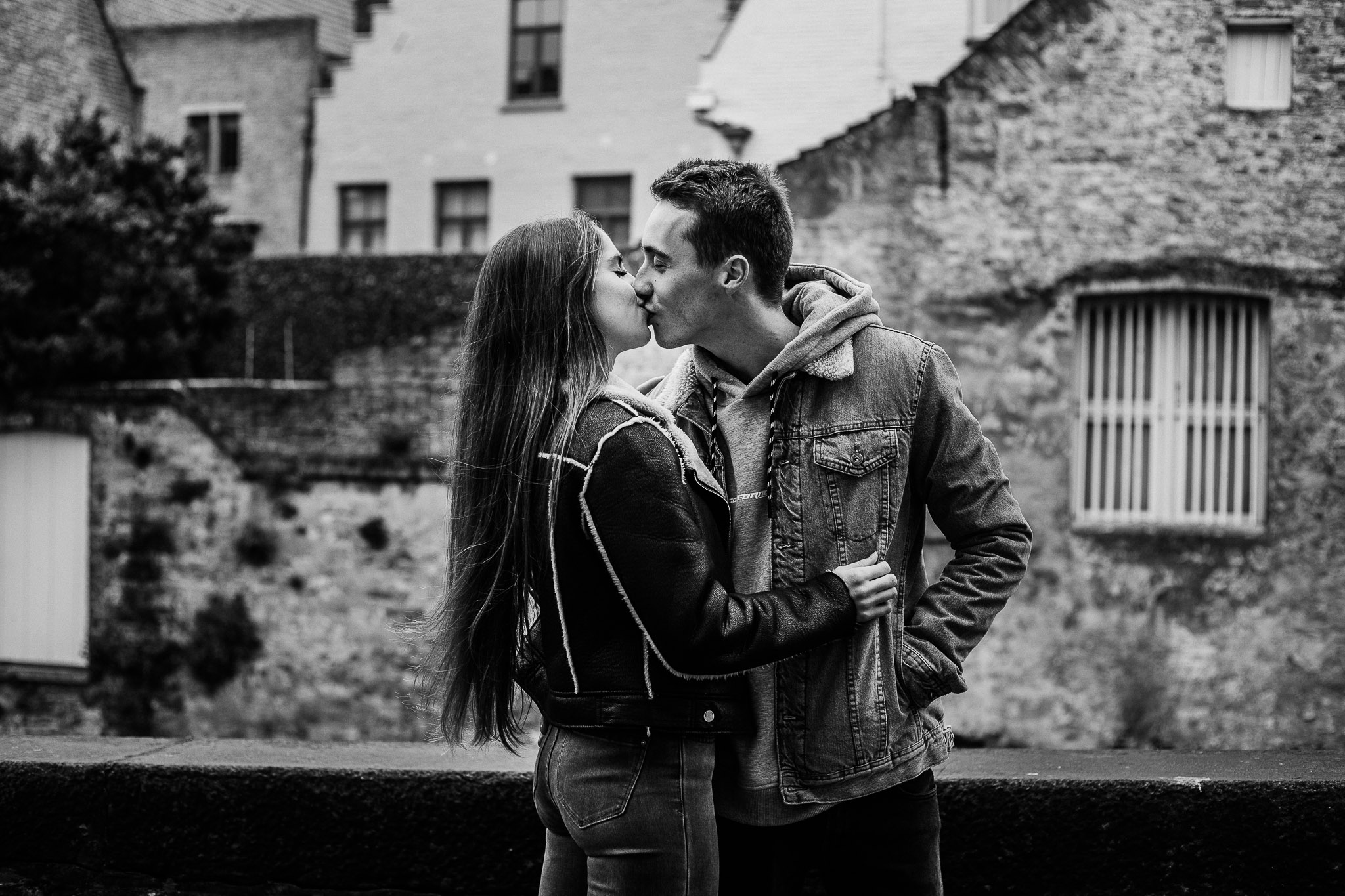 Romantic kiss alongside the canal in Bruges, Belgium