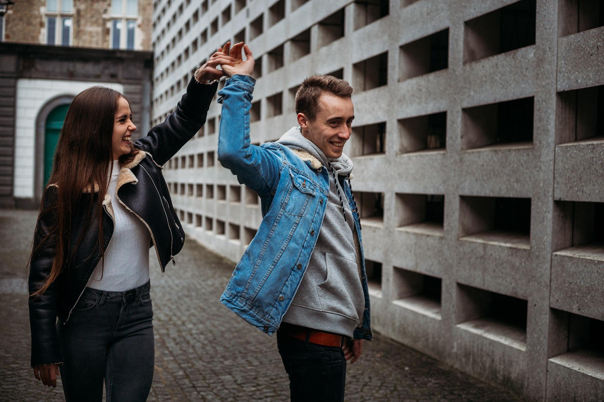 Couple dancing in the street in Bruges, Belgium