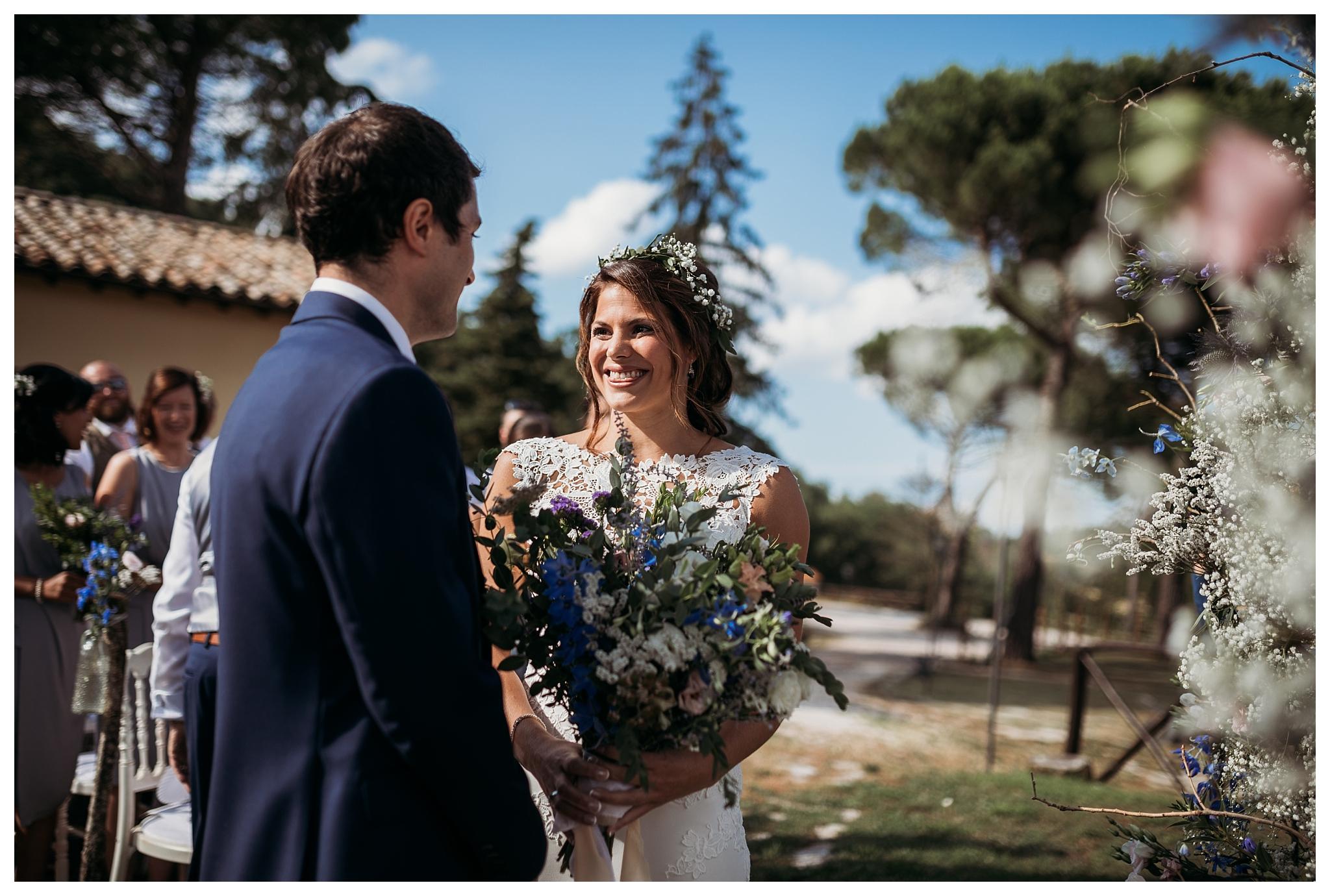 Bride arrives to the ceremony at Tenuta di Casa Bruciata