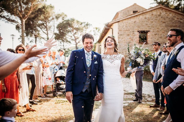 Confetti moment after a ceremony at Tenuta di Casa Bruciata, Italy