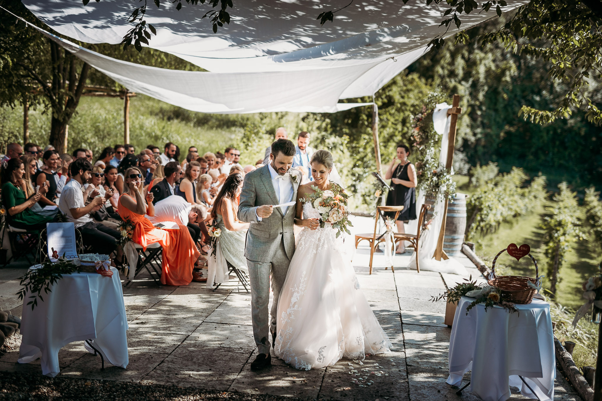 Bride and groom walking away from the civil ceremony at La Villa Hotel in Italy.