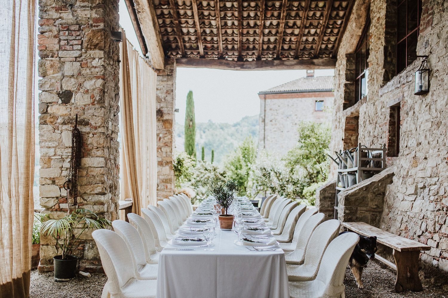 Imperial table wedding under a pergola in an ancient castle in Italy
