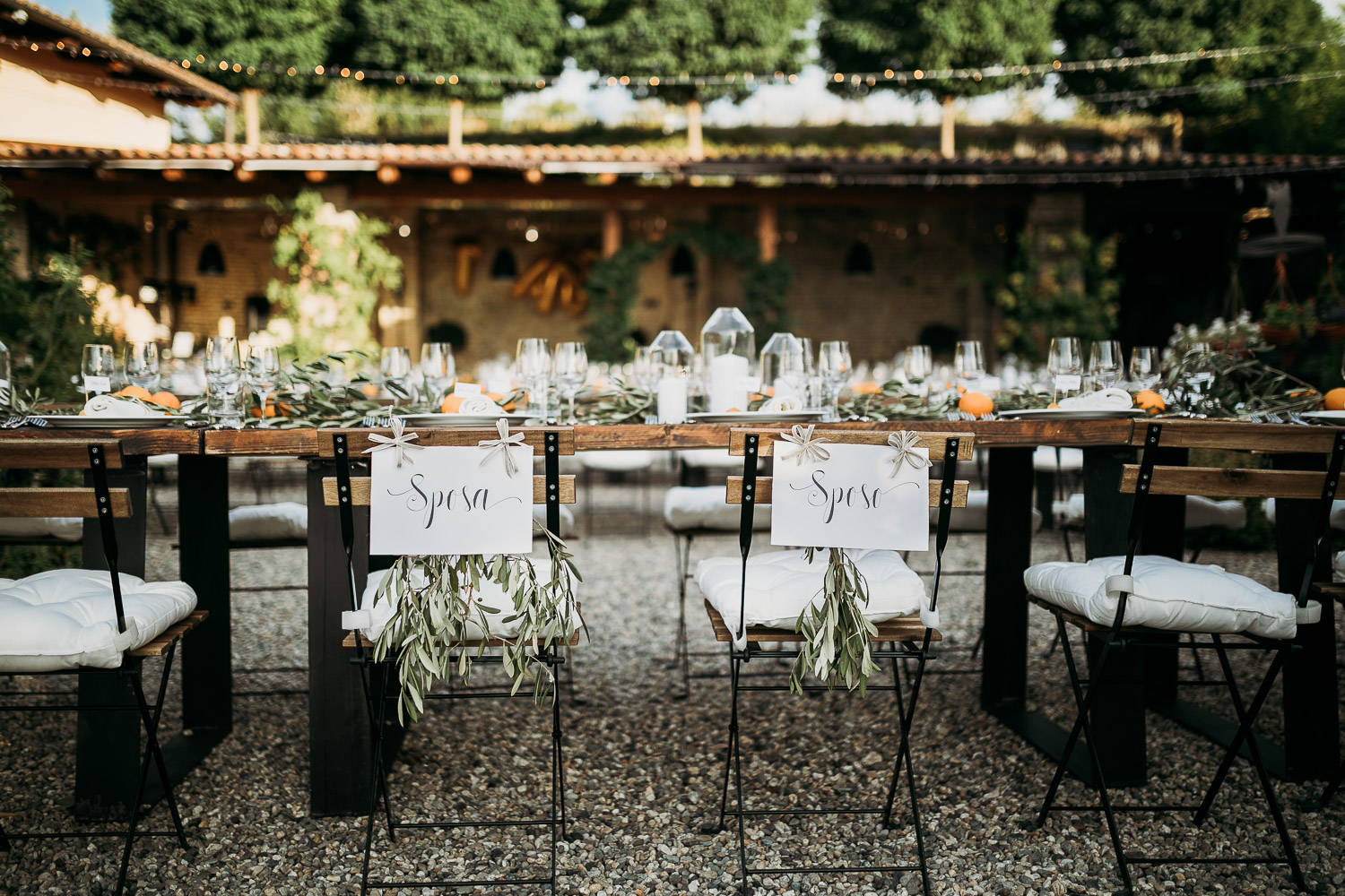 Bride and groom chair at the wedding table in italian style
