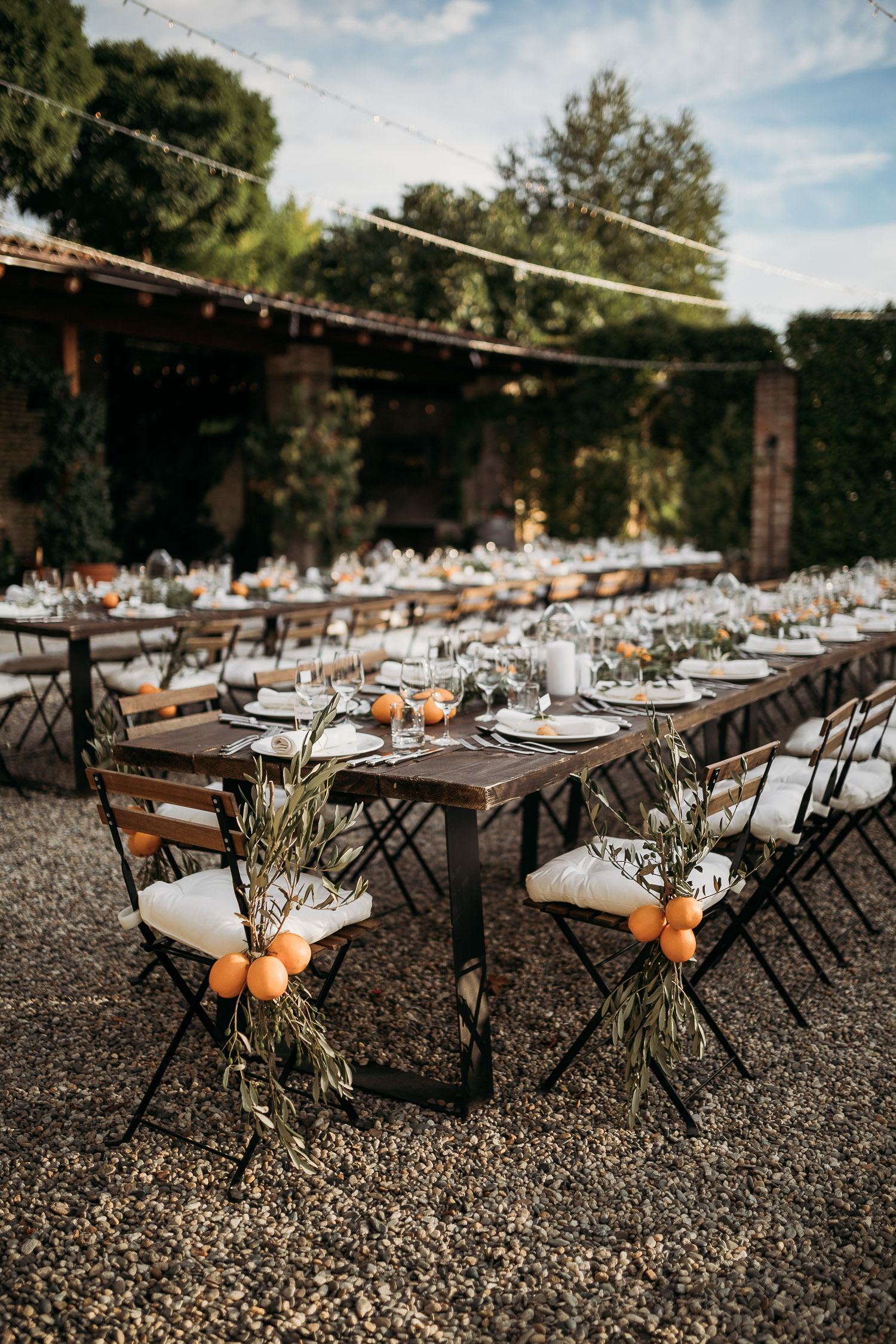 Table setting rustic and italian with oranges and olives branch