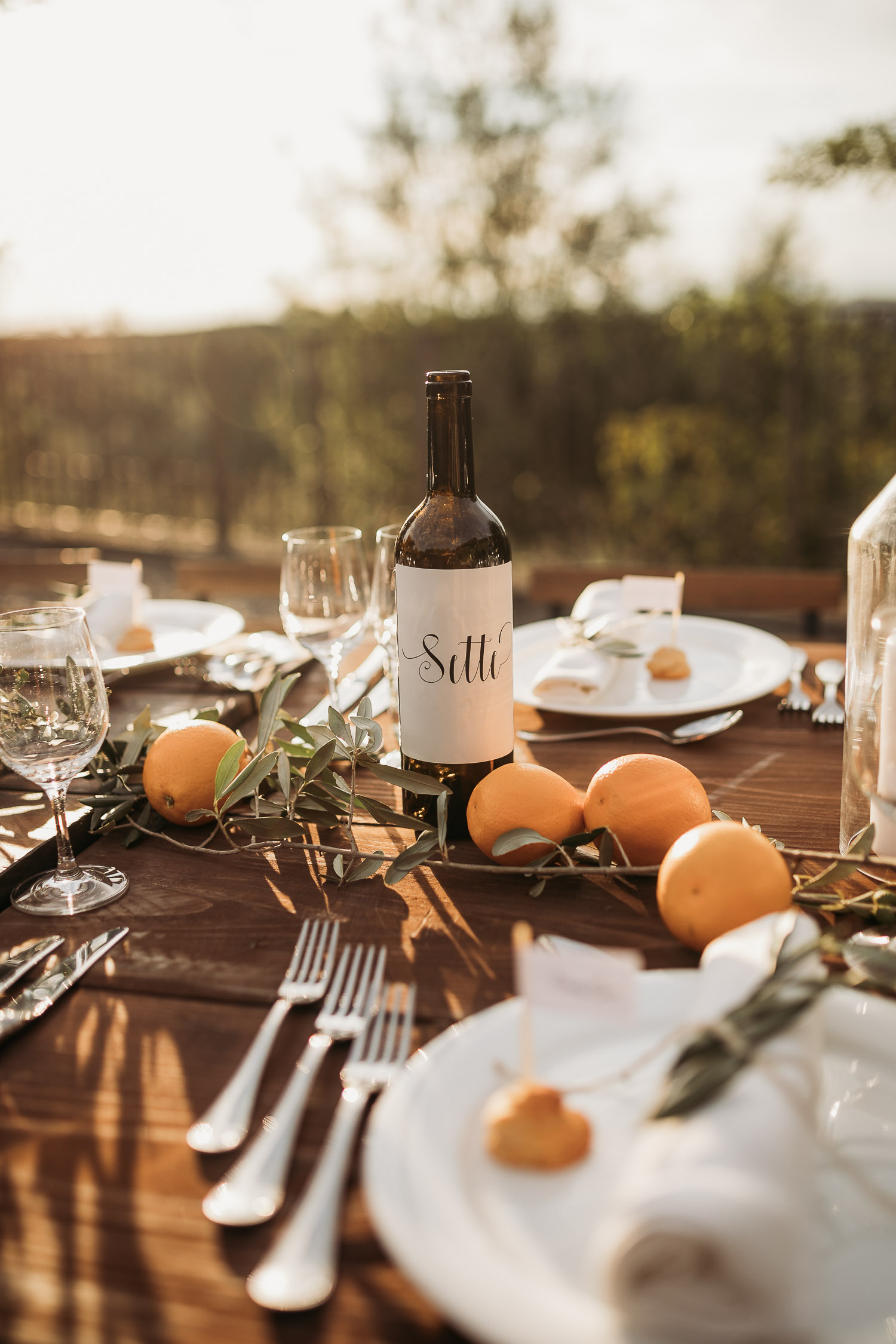 Wedding rustic table decor with orange and olives