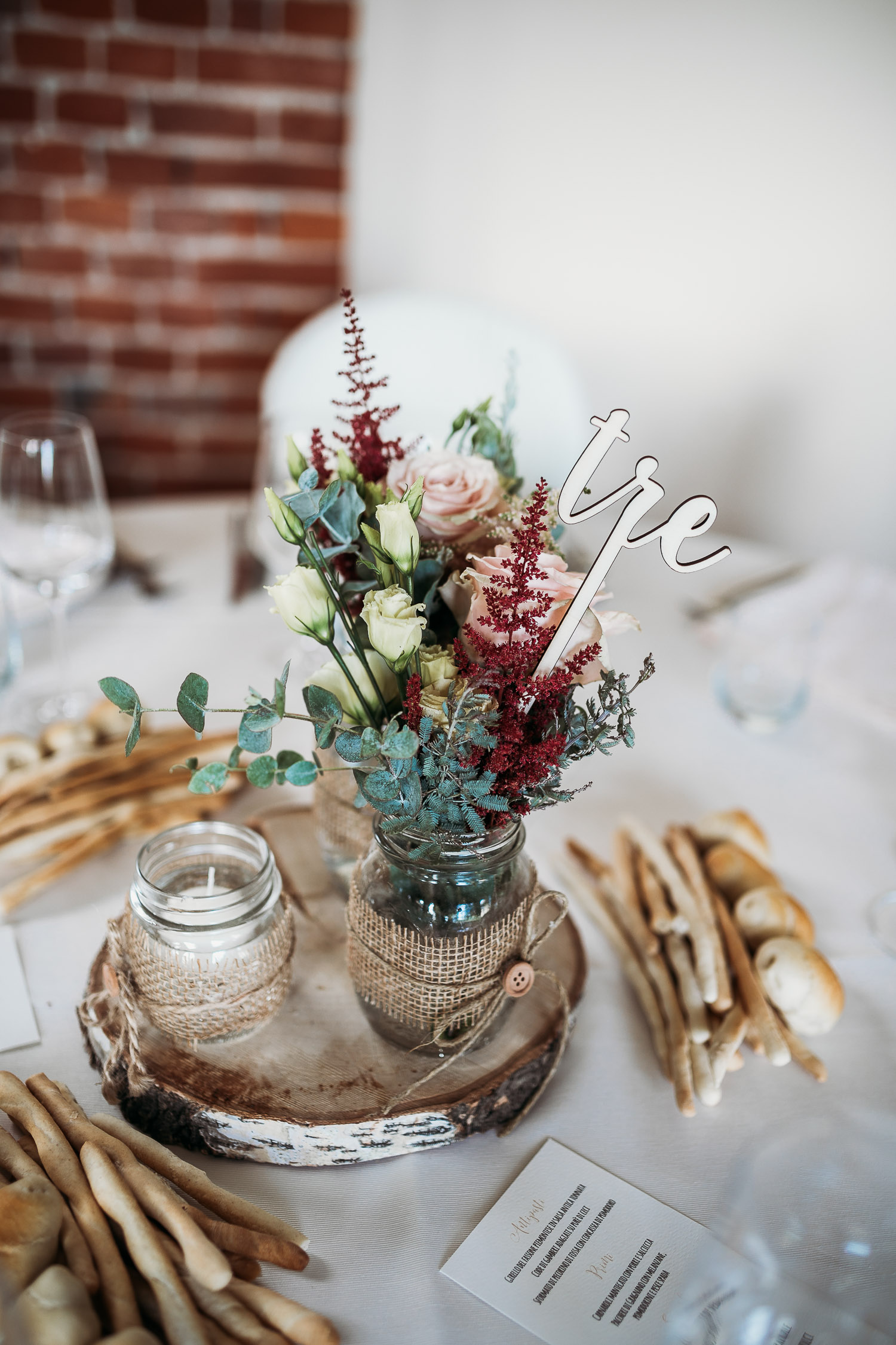 Centerpiece with wood and candles