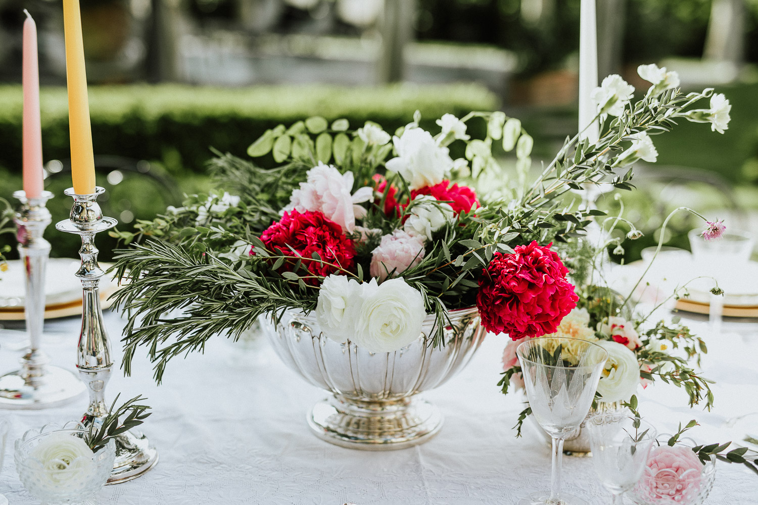 Cutlery with rosemary and red buttercup for a wedding in Italy at Villa Beccaris